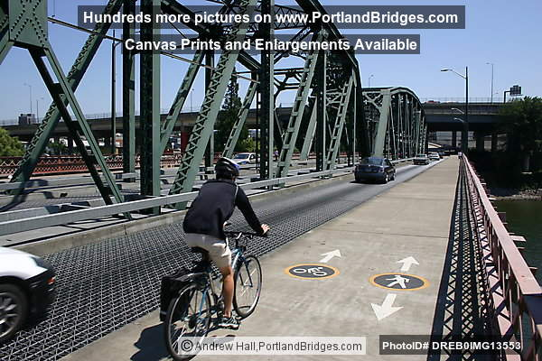 Cyclist Riding on Hawthorne Bridge (Portland, Oregon)